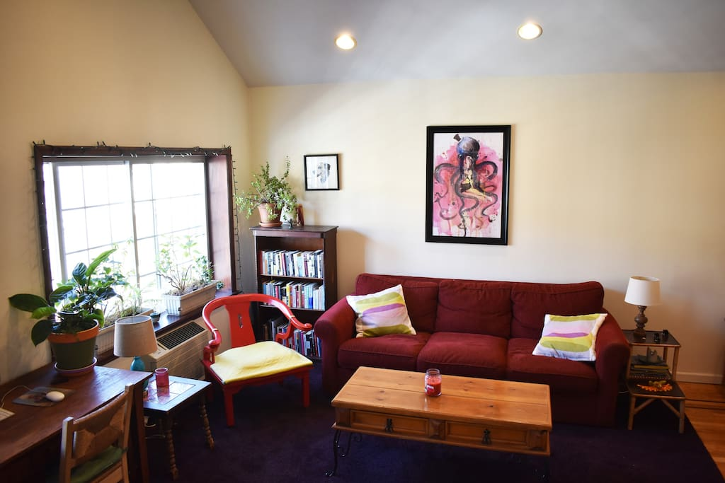 Spacious and bright Living Room. Comes with a very thick and plush eggplant-colored carpet to roll around on if you wish.