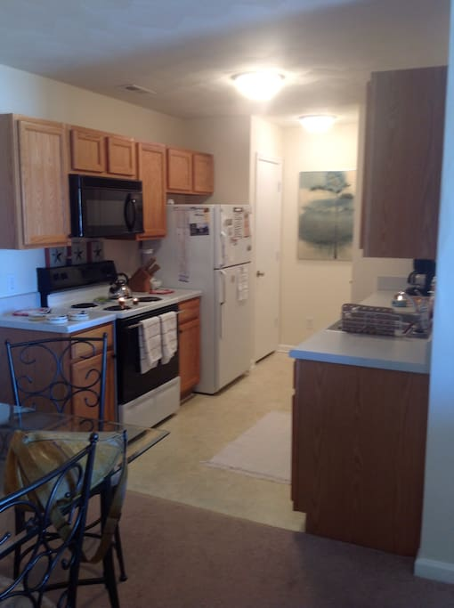 Kitchen is fully equipped for your every need. From toaster ovens to microwave, stove, blender,pots and pans, dishes, coffee maker, and even a dishwasher.