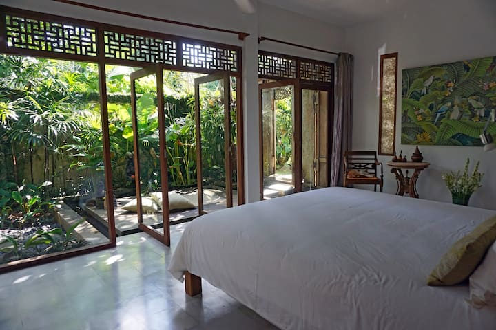 The air-conditioned master bedroom has its own courtyard garden