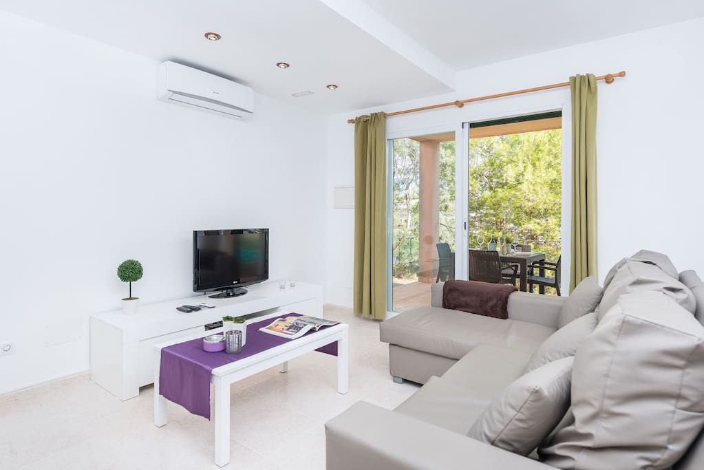 living room with air conditioning and satellite tv