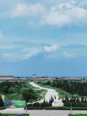 欢乐海洋之家1 Ocean view apartment 威海荣成那香海纹石宝滩洲际香亭海岸海景公寓