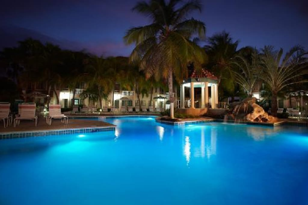 Back pool w/ 8 person jaccuzzi.  Both pools illuminate at night too!