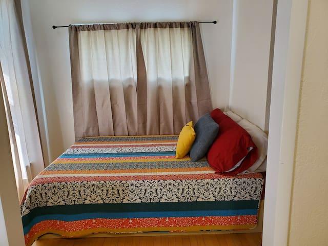 Brand new, comfy bed in cozy corner.