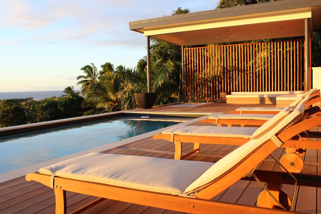 Unobstructed Pool and cabana with sunken day bed and sofa looking out over the land and sea.