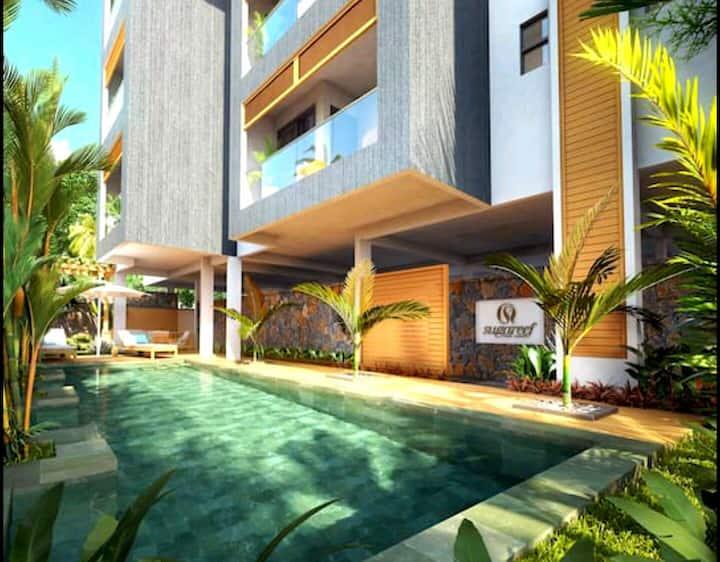 Beach Apartment w Beautiful Mountain & Pool Views