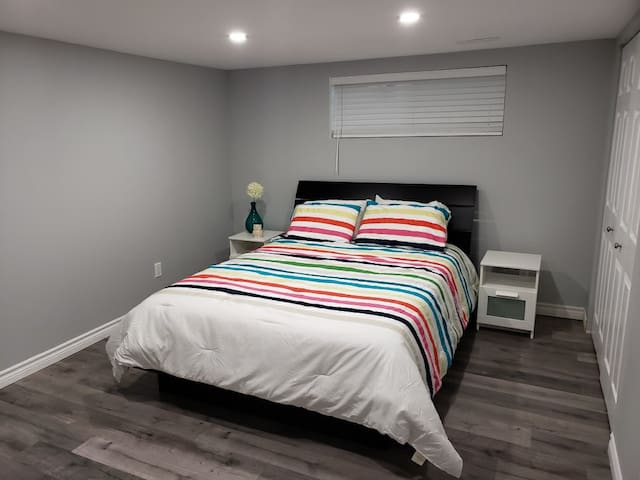 Large room with a comfortable queen bed with memory foam mattress topper!