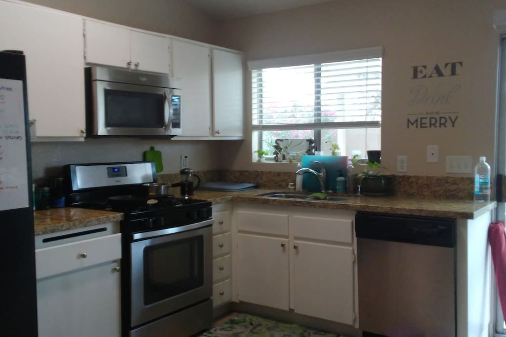 """""""Eat, drink and be merry"""" in a clean kitchen with lots of counter space and updated appliances"""
