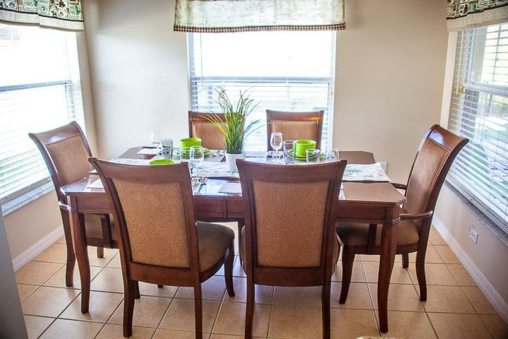 Dining area with six chairs with wide double sides windows
