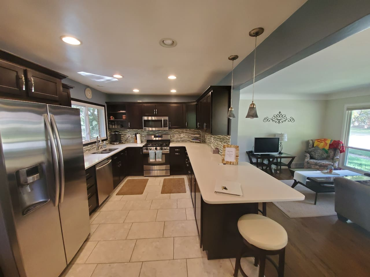 Amazing large kitchen with peninsula,  dining table and open floor plan to tv room.