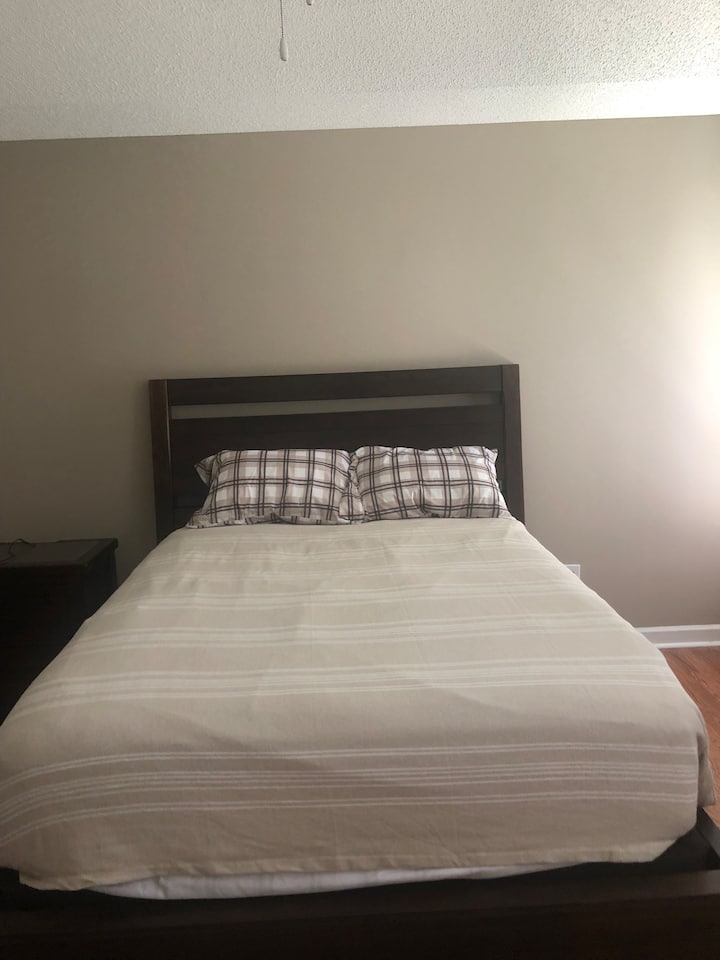 Queen size bed for two close to Vidant And ECU