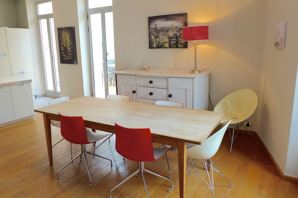 Large dining table for relaxed meals with friends or family.