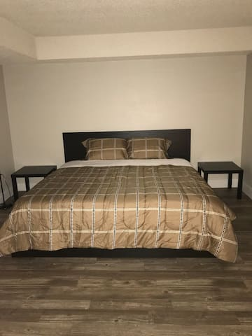 Master bedroom with a private bathroom close strip