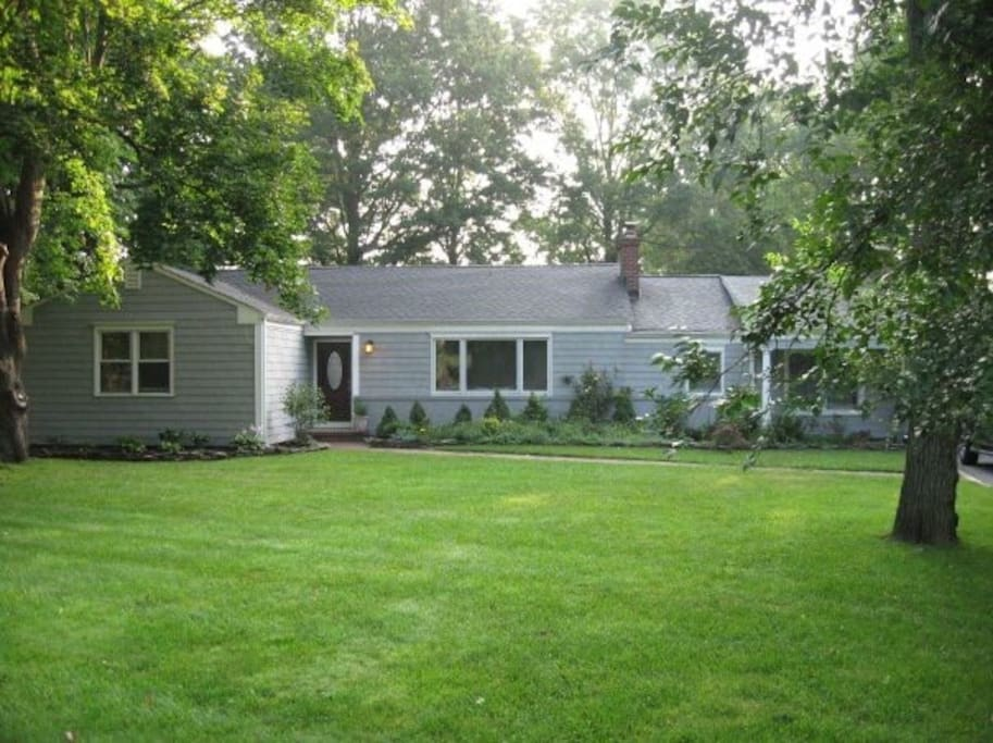 Beautiful renovated ranch with mature trees and lots of green!