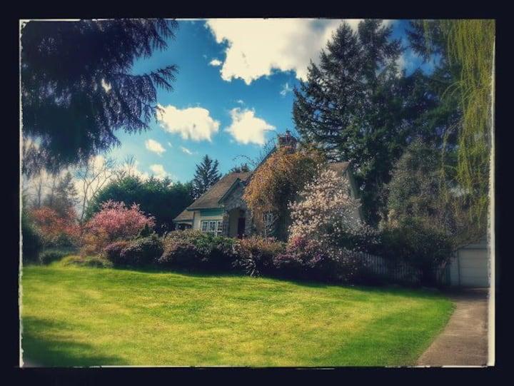 English cottage nestled  in gardens