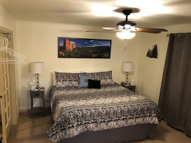 BEDROOM #1  The master bedroom has a king size bed.  It's nicely decorated in light grays and the 3-speed  fan circulates the air nicely as you sleep.  The night stands are equipped with chargers for your cell.  A suitcase stand on opposite wall.
