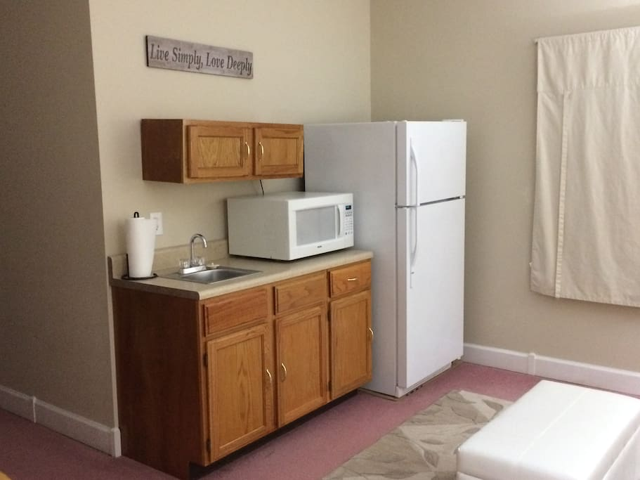 Kitchenette:  full-sized fridge, microwave (no stove), pantry and single cup Keurig.