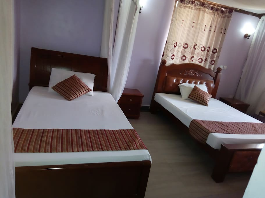 Twin room.  Spacious, TV,fan,hot shower,closet,balcony, working table,mosquito net, access card