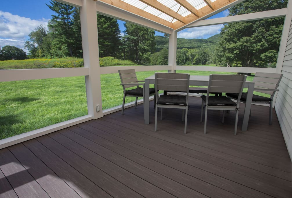 Screened in deck has views of fields and mountains