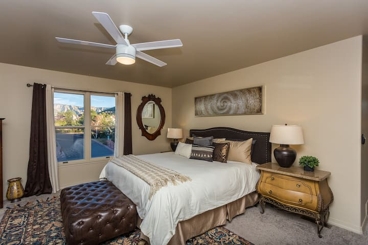 Comfortable king bed in Master bedroom, with down bedding
