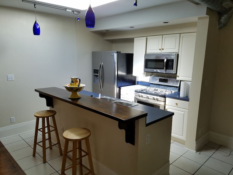 Great kitchen with all stainless appliance... gas 5 burner stove, microwave, dishwasher, and large fridge! Equipped with everything you need for home dining. Skylight lets the sun shine in for a bright day.