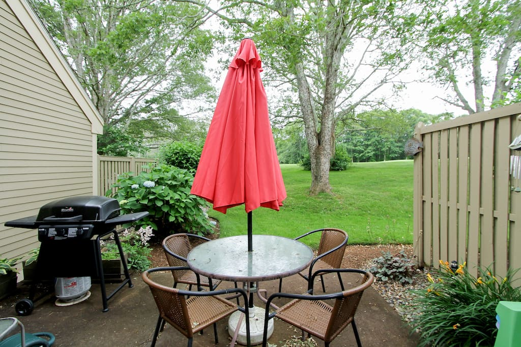 Sliding glass doors lead you to the patio, where another dining table seats four