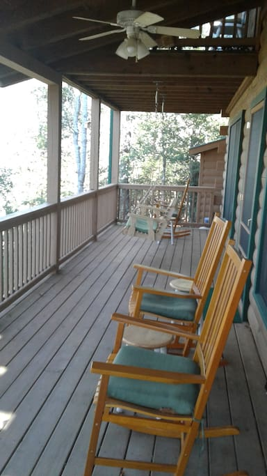 large covered porch with grill