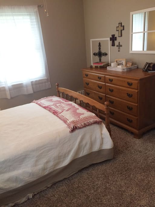 Private guest bedroom with closet space and storage drawers