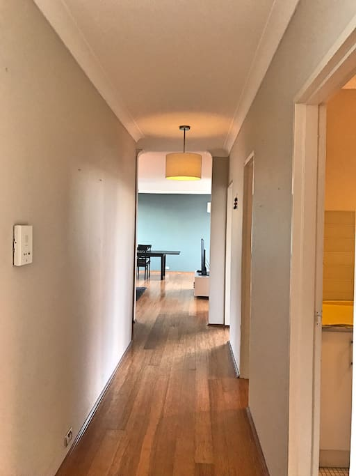 Hallway to laundry, guest bathroom and living room