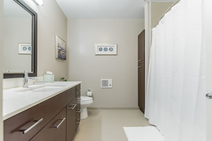 Second bathroom has a tub/shower combo.