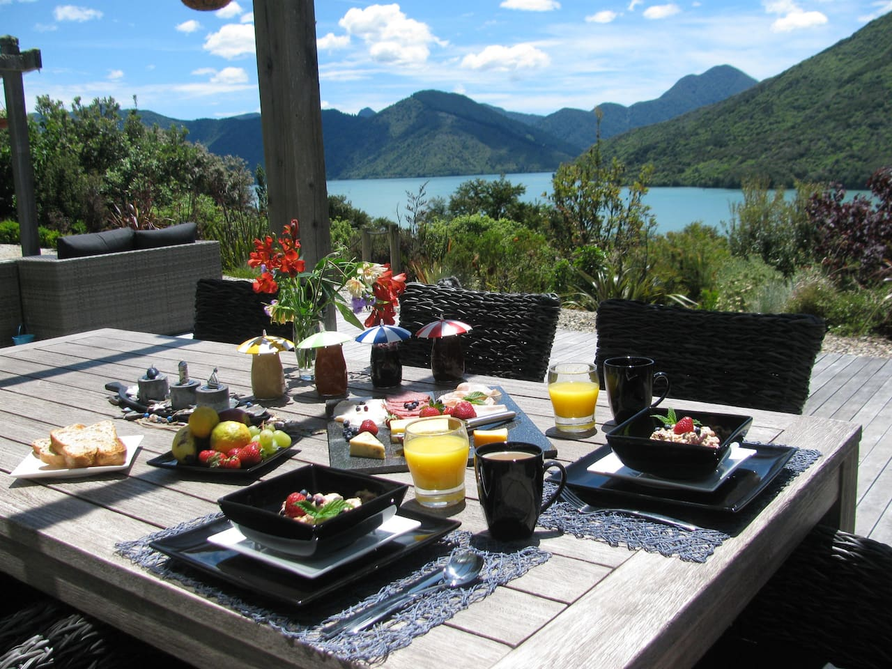 comprehensive breakfast on the patio with stunning seaview