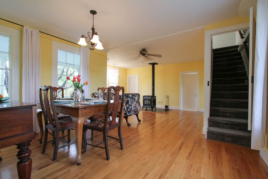 Long view from kitchen to dining room and living room. Stair case to upstairs. R.