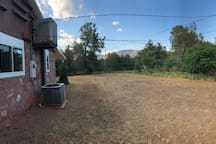 Back yard with views to red rocks.