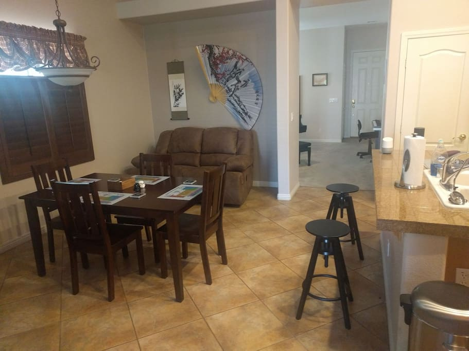 The dining room and kitchen are a spacious place to lounge so you don't get cooped up in the guest room.