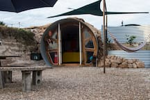 In keeping with our sustainable lifestyle, the hobbit hole and accessories are all constructed from recycled or re-purposed materials.