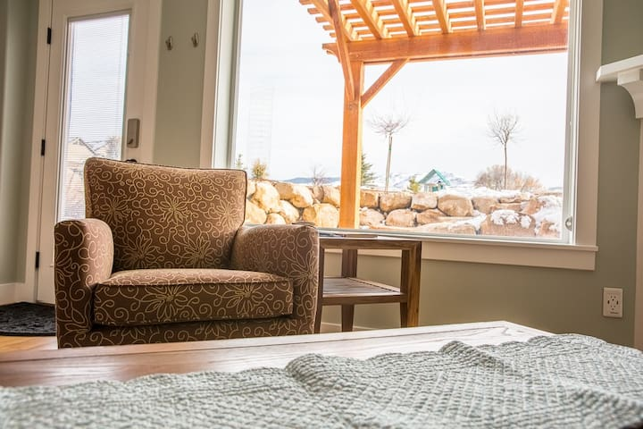 Enjoy a peaceful morning in this cozy chair with a view