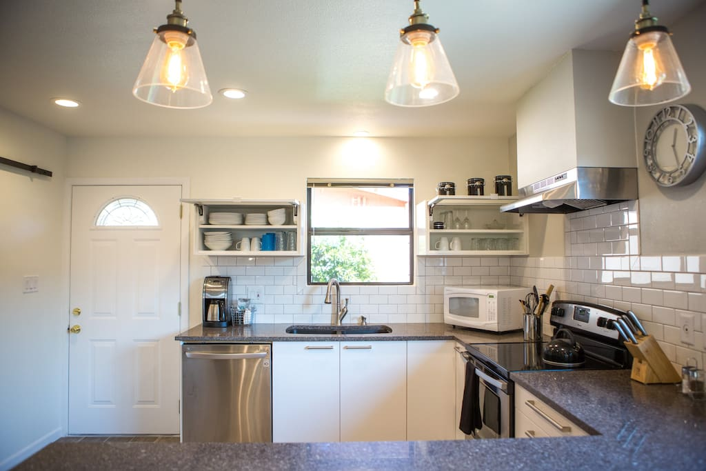 Our roomy kitchen is fully equipped for your convenience.