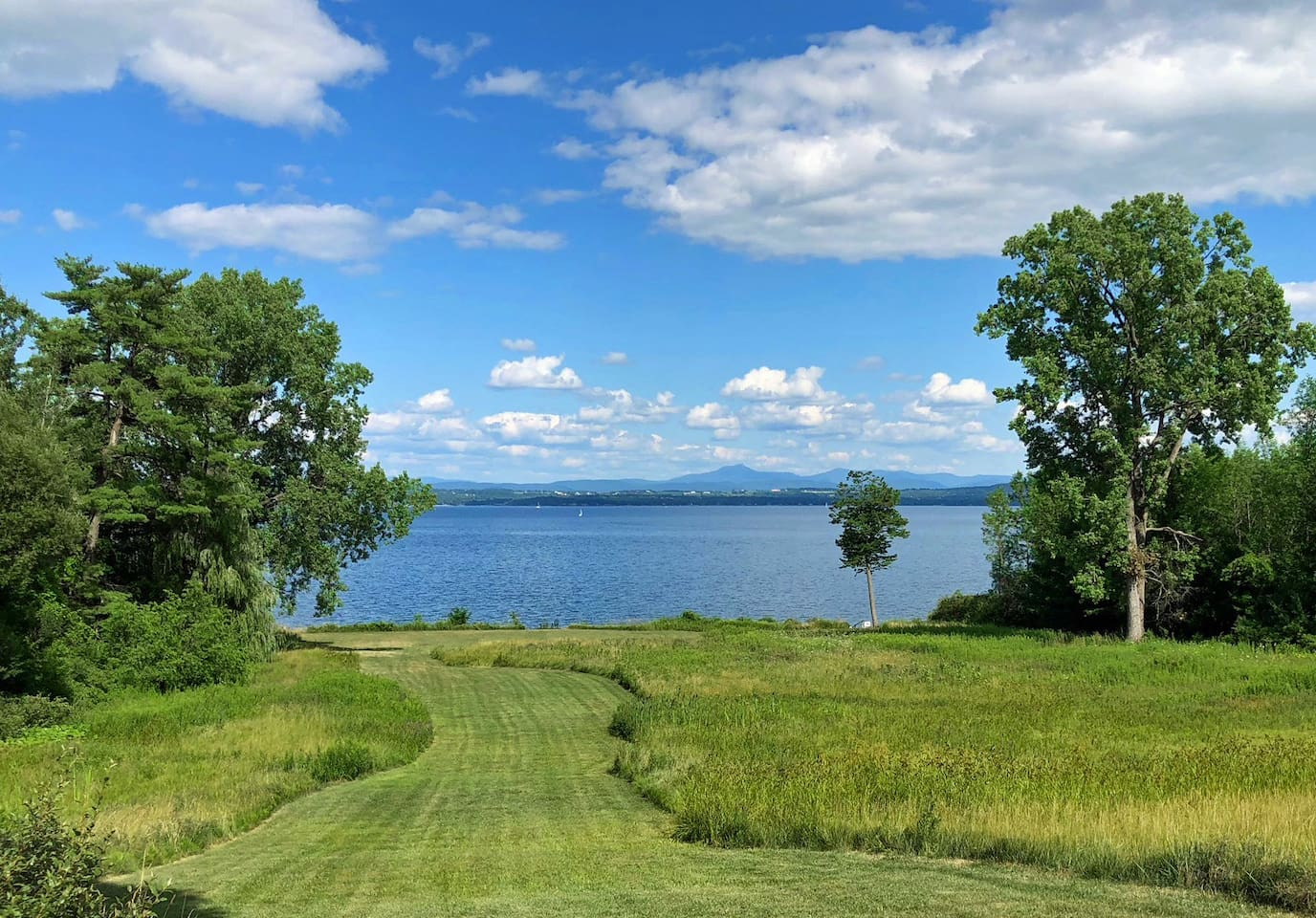 Paradise found! Lake Champlain (and Vermont's Green Mountains) at the bottom of a long private lawn.