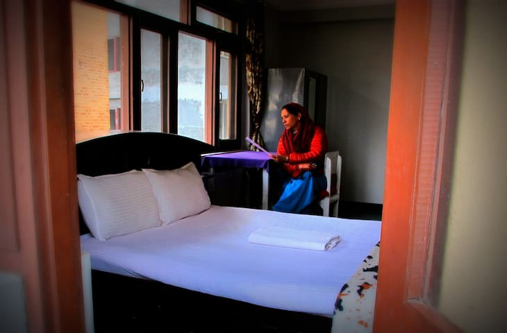 Spacious homestay room w balcony in Jhamsikhel