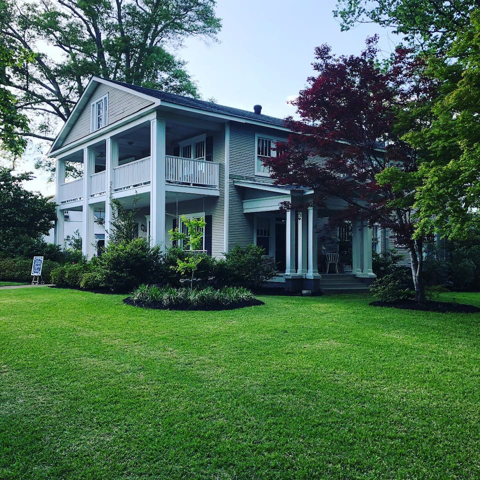The setting of this beautiful Southern home couldn't be lovelier—a lush double lot adored with trees and flowers, within walking distance to historic downtown Louisville, MS.