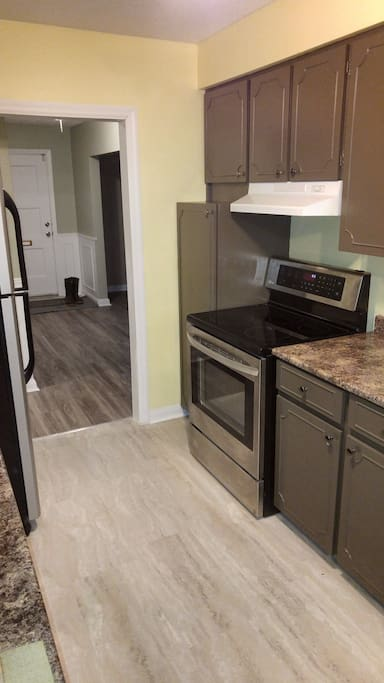 Kitchen has Blender, Toaster, Coffee maker, Oven and Refrigerator. No microwave.
