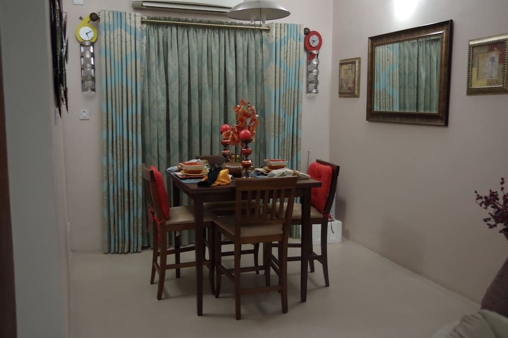 Dining room with pre-set dining set for 2.