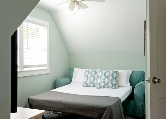 Front living room has pull-out queen bed complete with pillows and linens