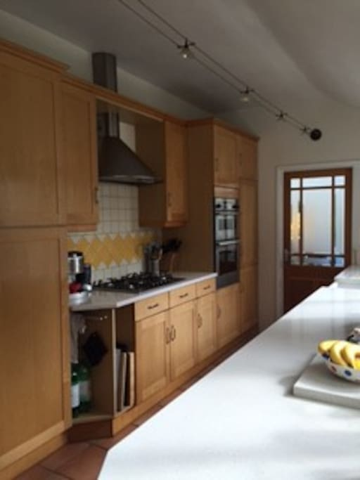 Kitchen with fridge freezer and washing machine