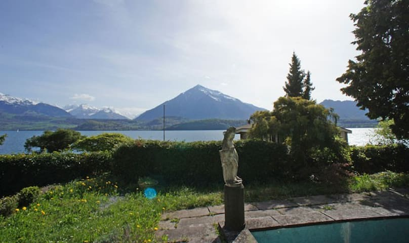 The terrific view of nearby Thunersee, seen from the main garden