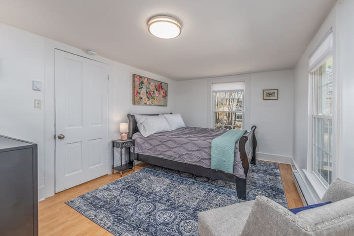 Bright, comfy bedroom with Queen size bed and full dresser plus a walk in closet!