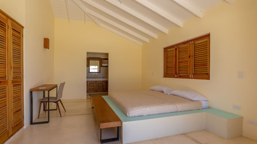 Bungalow next to villa: RIGHT bedroom with king bed, ac, bathroom with sink, toilet and shower.