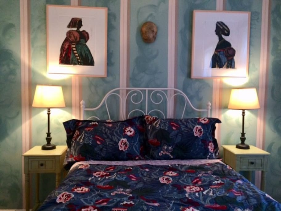 The bed is made up with four pillows, a top sheet and duvet with cover.