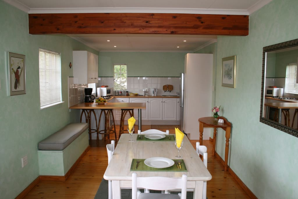 Kitchen dining area with full complete kitchen.