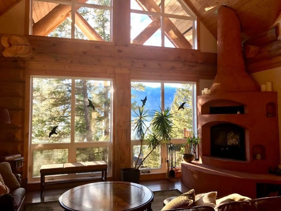 Large family room with couch that seats 6-8. Great views of the lake. Custom adobe fire place.