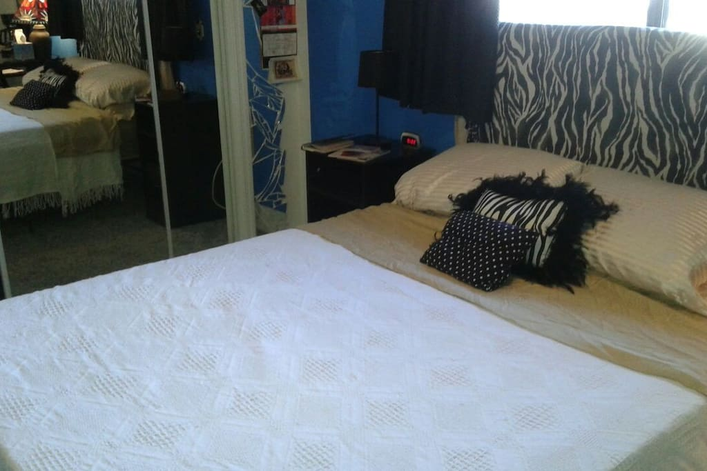 Zebra room's queen size memory foam bed.